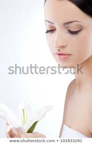 woman holding lily flower spa theme stock photo © chesterf