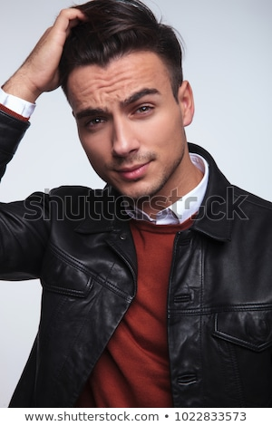 man in leather jacket passing his hand thorugh his hair Stock photo © feedough