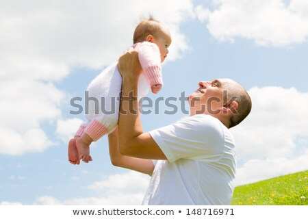Father holding small baby aloft Stock photo © AndreyPopov