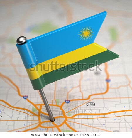 Rwanda Small Flag on a Map Background. Stock photo © tashatuvango