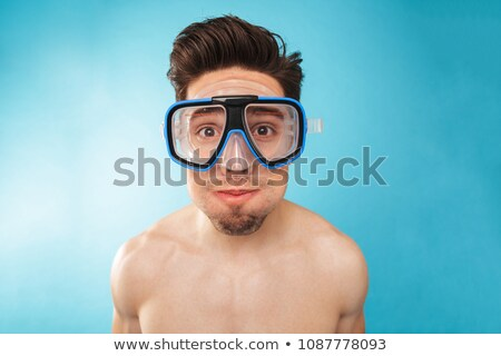 Smiling young man in swimwear Stock photo © stockyimages