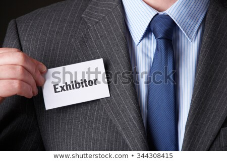 Businessman Attaching Exhibitor Badge To Jacket Stock photo © HighwayStarz