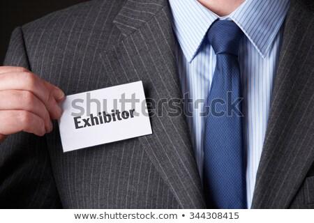 Businessman Attaching Exhibitor Badge To Jacket Stock photo © HighwayStarz