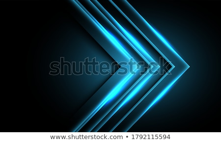 blue glowing arrows on black background stock photo © saicle