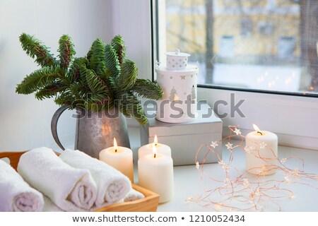 A burning christmas decorated candle  Stock photo © olandsfokus