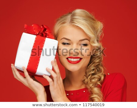 Alluring woman holding the Christmas box Stock photo © konradbak