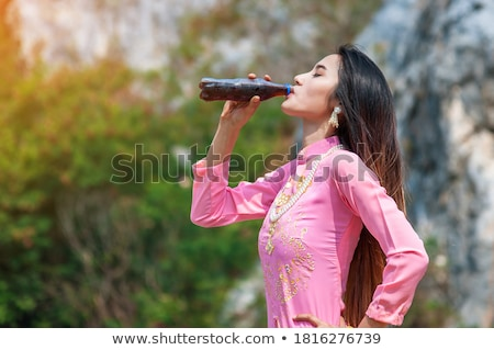 pretty vietnamese woman standing in water stock photo © smithore