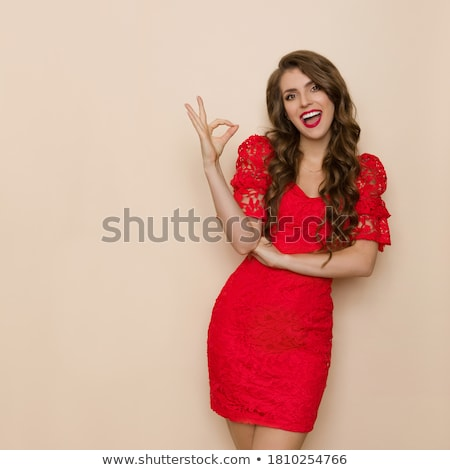 Smiling Lady in Elegant Dress with Hands on Waist Stock photo © juniart