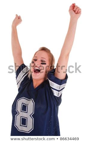 Cheering football fan in blue jersey Stock photo © wavebreak_media