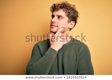Sonriendo pensando mano barbilla blanco Foto stock © wavebreak_media