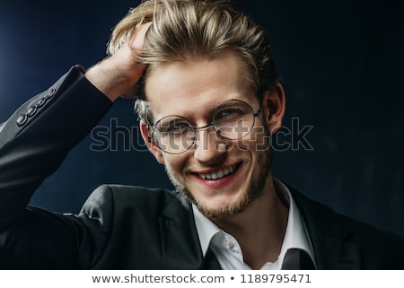 Smiling young fashion man closing his jacket Stock photo © feedough