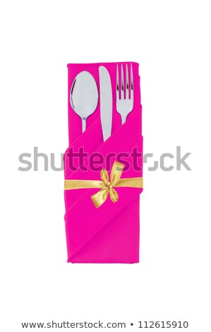 Stock photo: Fork, spoon and knife in pink cloth with golden bow isolated on