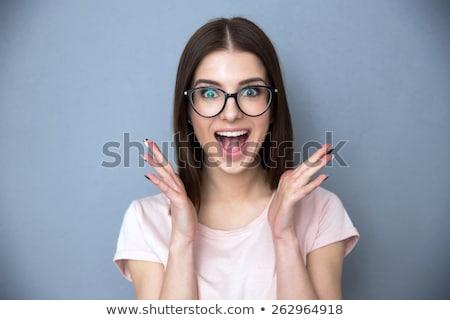 Retrato maravilhado mulher em pé cinza Foto stock © deandrobot
