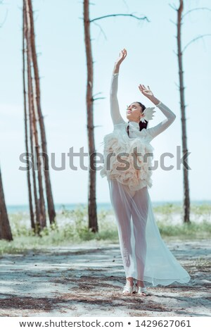 beautiful brunette over blue sky posing in white dress holidays stock photo © victoria_andreas