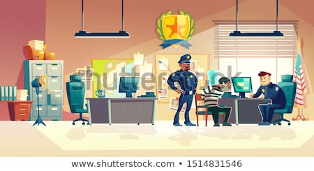 Police handcuffs on investigator detective's work desk Stock photo © stevanovicigor