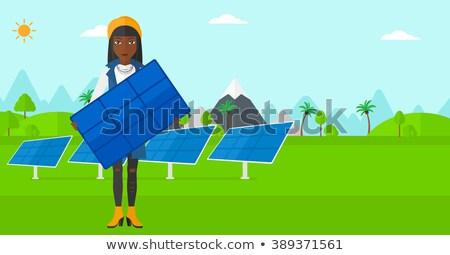Vrouw zonnepaneel jonge vrouw permanente handen Stockfoto © RAStudio