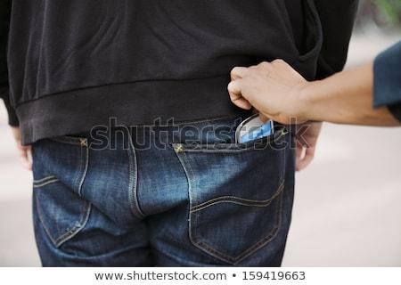 Hand mobiele telefoon jeans Maakt een reservekopie zak mannelijke Stockfoto © stevanovicigor