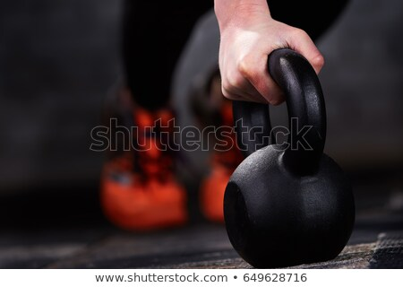 Close up photo of fitness hand and kettlebell Stock photo © deandrobot