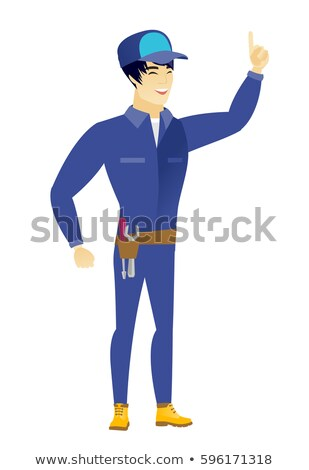 Asian mechanic pointing with his forefinger Stock photo © RAStudio