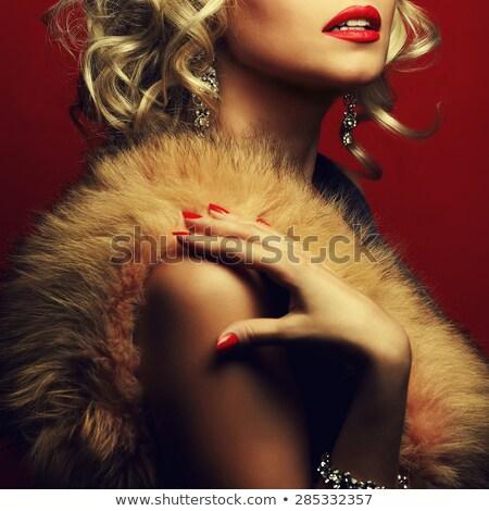 beautiful young blond woman in fur studio shot stock photo © konradbak