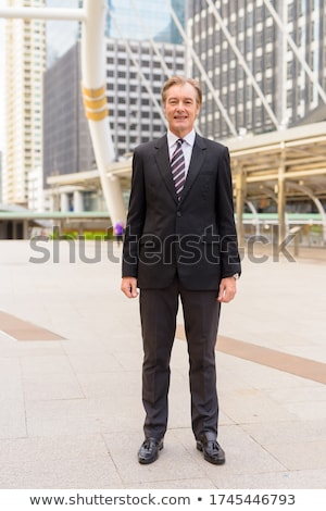 businessman at skywalk happy stock photo © is2