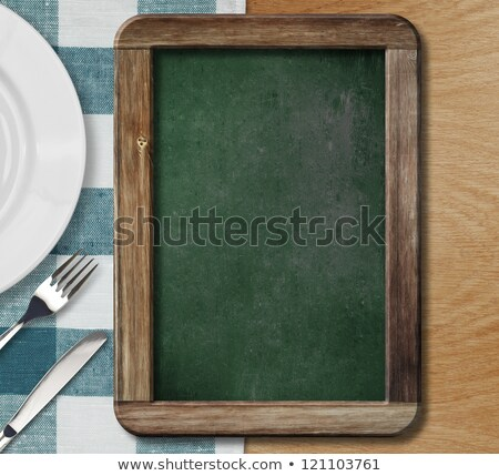 Stock photo: Cutlery top view. Blank White Plate, fork and knife lying on a n