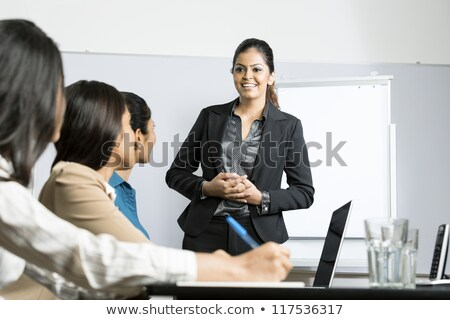 Asian woman doing business presentation Stock photo © studioworkstock