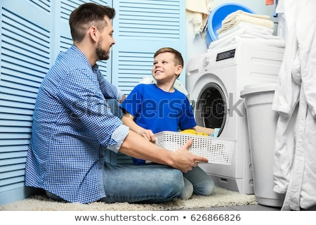 Father and son folding laundry Stock photo © IS2