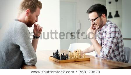 Joven jugando ajedrez mesa juego masculina Foto stock © IS2