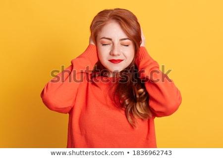 Femme oreilles doigt fête fond Photo stock © AndreyPopov
