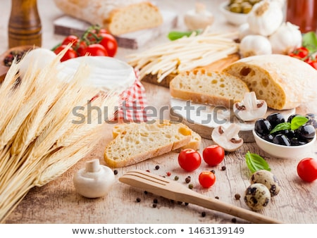 homemade wheat bread with quail eggs and raw wheat and fresh tomatoes on wooden background classic stock photo © denismart