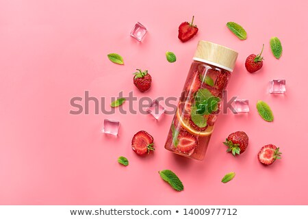 Strawberry and basil on pink background. Flat lay stock photo © Illia