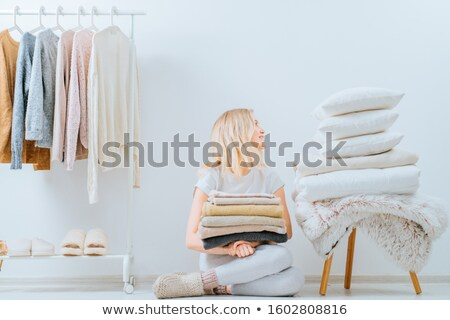 woman with bath towels and drying rack at home Stock photo © dolgachov