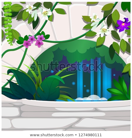 Artificial garden of tropical flowers and stone decor. Poster on the theme of nature. Growing plants Stock photo © Lady-Luck