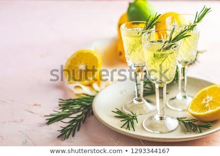 Lemon alcohol drink liqueur limoncello with pieces of lemon Stock photo © artsvitlyna