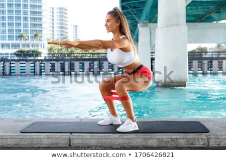 Happy Woman Doing Squat Exercise Stock photo © AndreyPopov