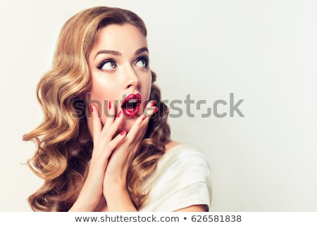 Beautiful shocked woman surprising looking and screaming at camera. Stock photo © studiolucky