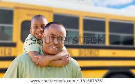 African American Man and Child Piggyback Near School Bus Stock photo © feverpitch