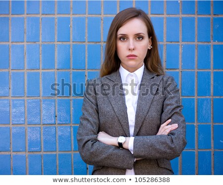 Sad beautiful woman with folded arms in fashionable clothes against kissing couple. Stock photo © studiolucky