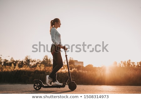 young woman riding a scooter stock photo © genestro