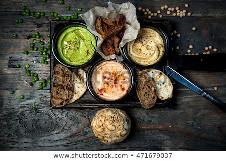 bowl of hummus on the wooden table stock photo © alex9500