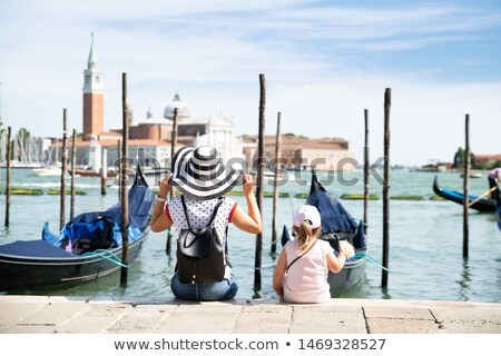 Mother And Daughter Sitting In Front Of The Gondolas Stock photo © AndreyPopov