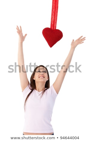 Young woman reaching out for red heart smiling stock photo © nyul