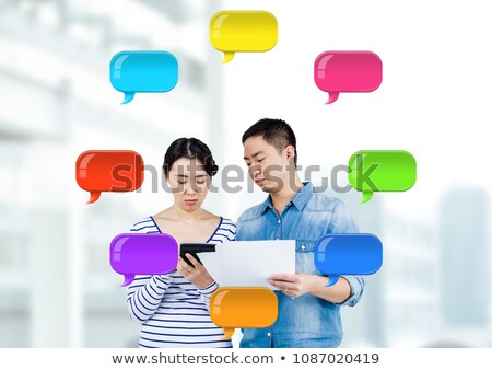 man and Woman on devices with shiny chat bubbles Stock photo © wavebreak_media