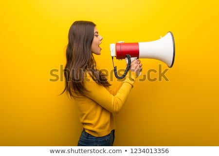 young woman or teenage girl with megaphone Stock photo © dolgachov
