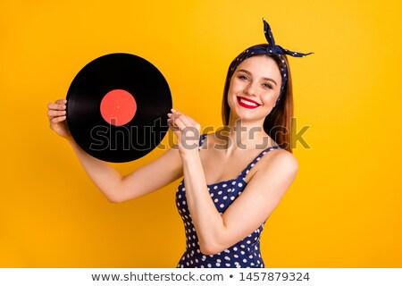 nő · tart · kompakt · lemez · lány · szem - stock fotó © vankad