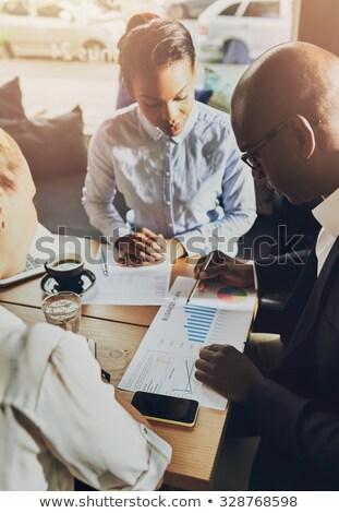 Vállalkozók megbeszél üzlet terv startup számítógép Stock fotó © Kzenon