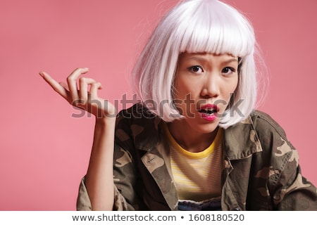 Image of asian girl wearing wig resenting and gesturing in indig Stock photo © deandrobot