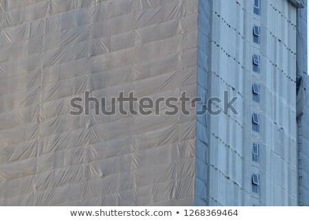 Edifício coberto andaime branco construção Foto stock © latent