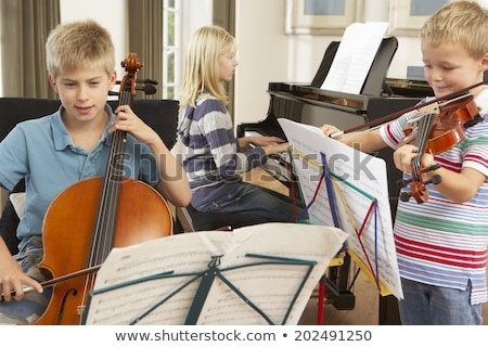 Three friends playing musical instruments Stock photo © photography33